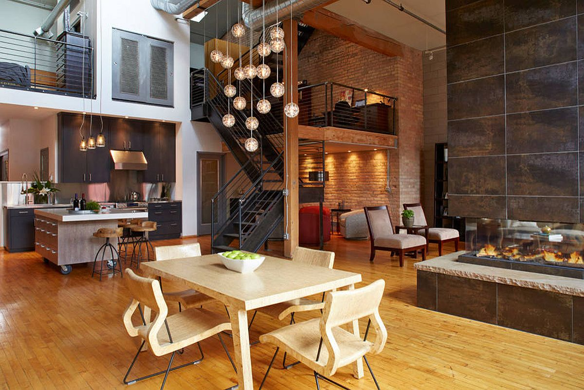 Industrial-style double-sided fireplace for the spacious modern-industrial living area
