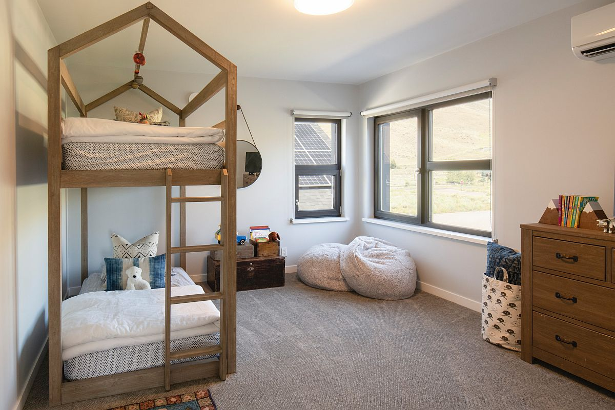 Lovely frame of the bed in wood takes centerstage inside this modern farmhouse bedroom