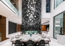 Mesmerizing-marble-fireplae-coupled-with-stunning-chandelier-in-the-dining-space-58754-217x155
