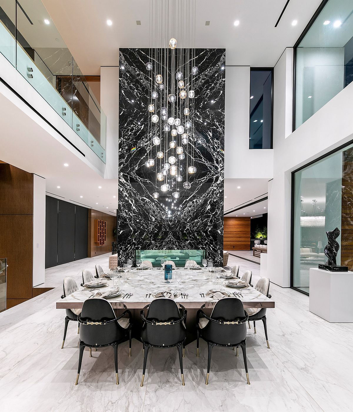 Mesmerizing marble fireplae coupled with stunning chandelier in the dining space