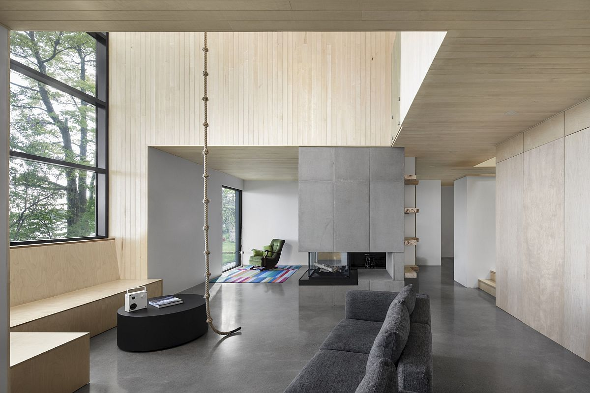 Minimal and contemporary interior of the cabin with a view of the lake promotes leisure lifestyle