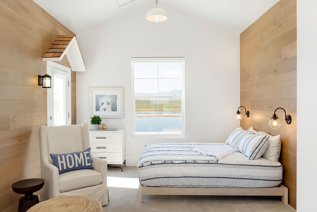 Modern, light-filled beach style kids' bedroom in wood and white with ample natural light