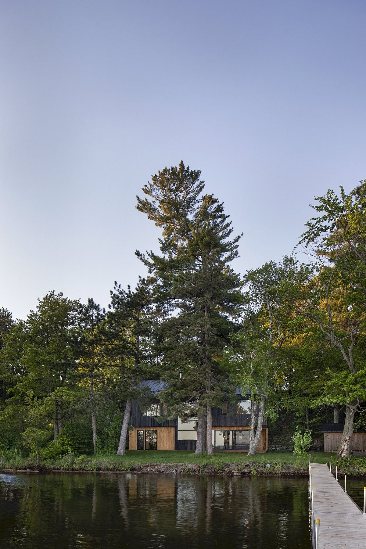 Natural greenery and a view of the lake steal the spotlight at this Lakeside Cabin in Canada