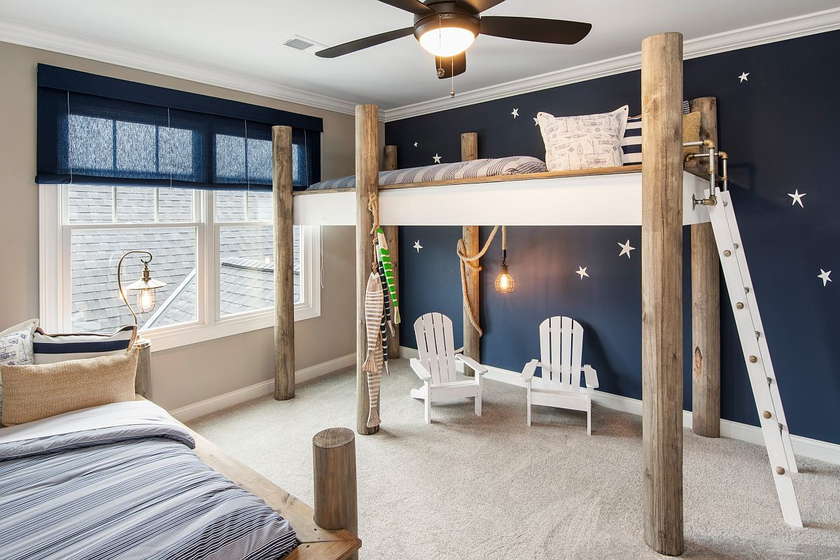 Picture-perfect and contemporary beach style kids' bedroom in deep blue with a bunk bed