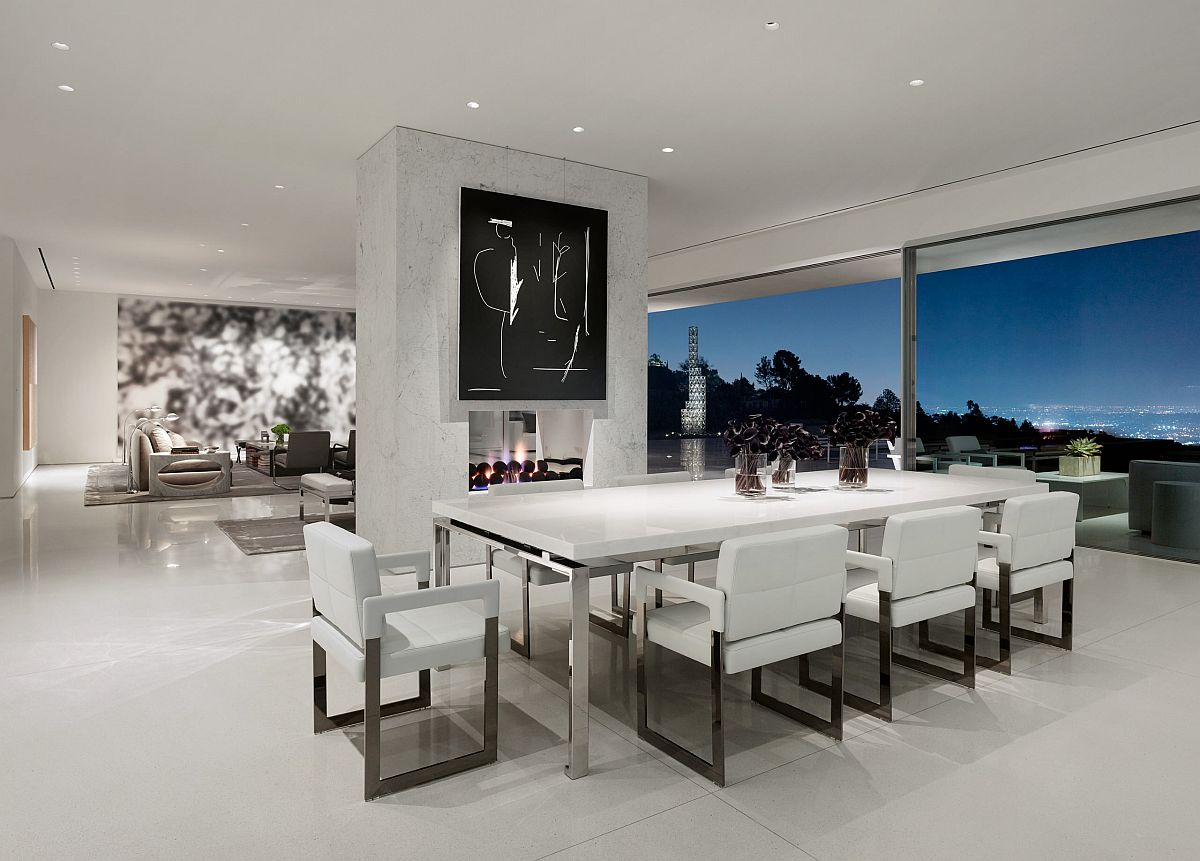 Polished contemporary dining room of LA home with spectacular views and a double-sided fireplace