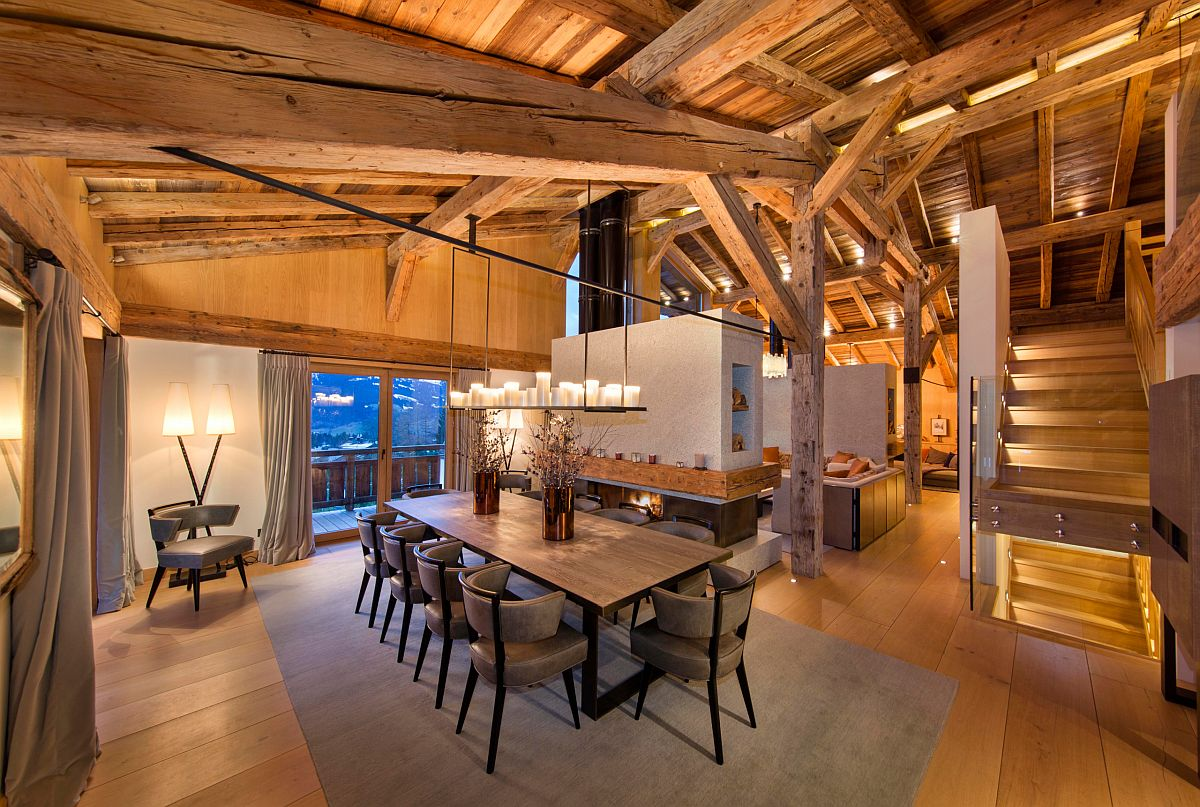 Rustic style dining room for Chalet-style home with a lovely two-sided fireplace