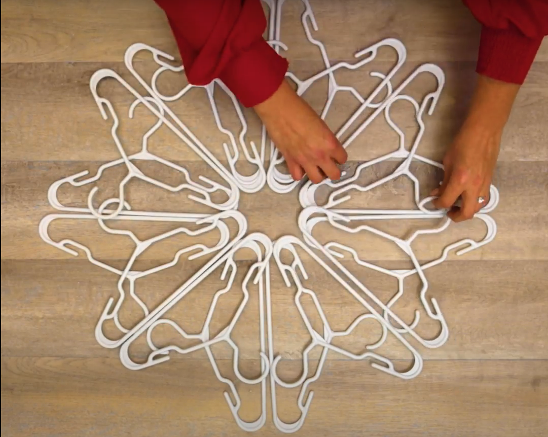 arranging second layer of hangers on snowflake
