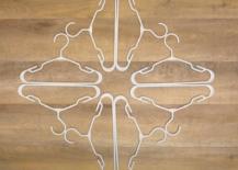 arranging first layer of snowflake hanger art