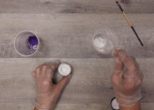 pouring pigment powder into plastic cups