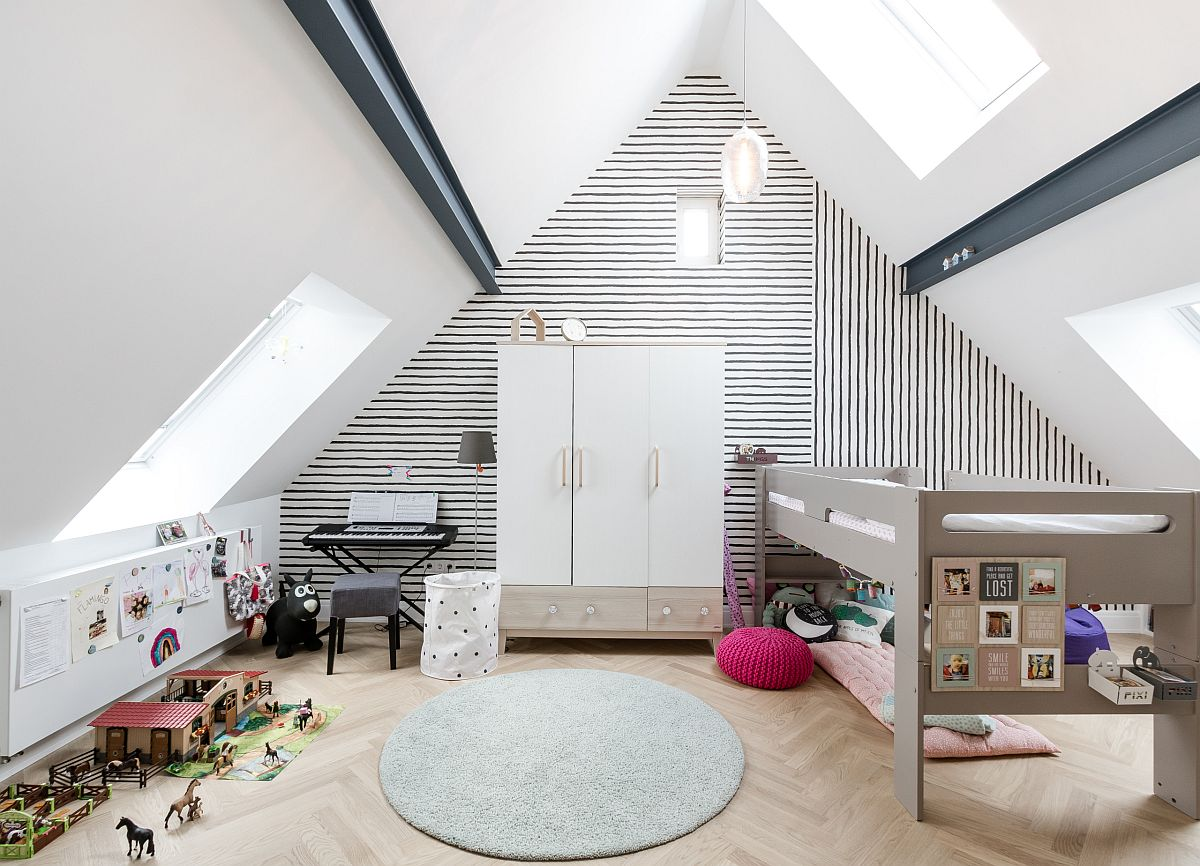 Simple black and white wallpaper with fun stripes add pattern to this attic kids' room without altering the color scheme