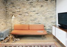 Small-upper-level-sitting-space-and-living-area-of-the-home-with-an-exposed-brick-wall-11917-217x155