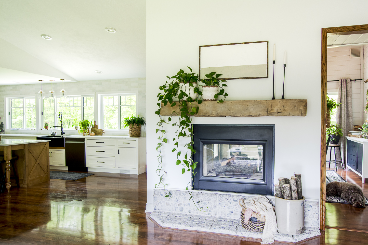 floating wooden beam mantel against white wall