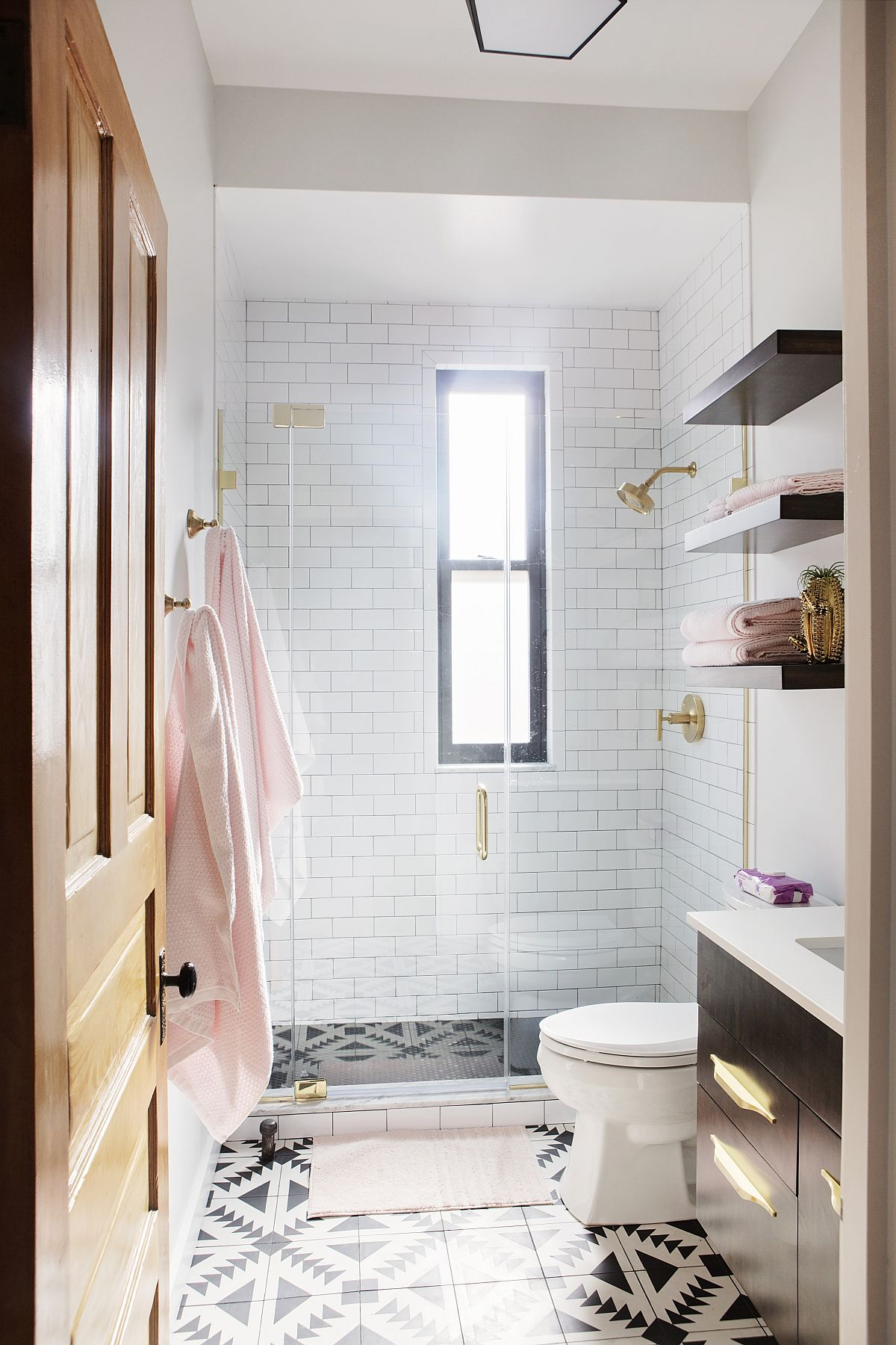 Tiles in black and white add pattern to the bathroom floor