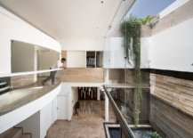 Upper-level-of-the-house-is-designed-to-overlook-the-public-areas-along-with-a-view-of-the-courtyard-98320-217x155