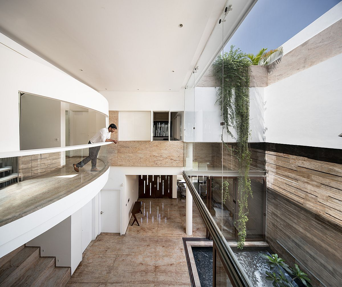 Upper level of the house is designed to overlook the public areas along with a view of the courtyard