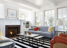 a clean crisp marble fireplace surround in a bright room