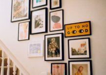 colorful gallery wall display ascending up staircase
