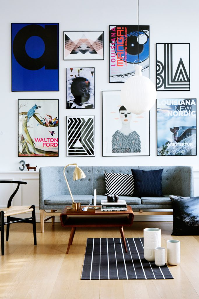 a bright display of photos in a botom-aligned gallery wall