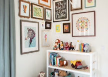 a corner gallery wall display in a child's bedroom