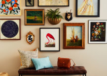 various art, photos, and prints displayed on gallery wall