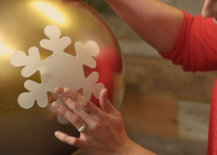 smoothing out snowflake decal on giant ornament