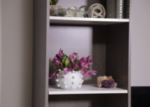 modern marble vase with flowers on shelf