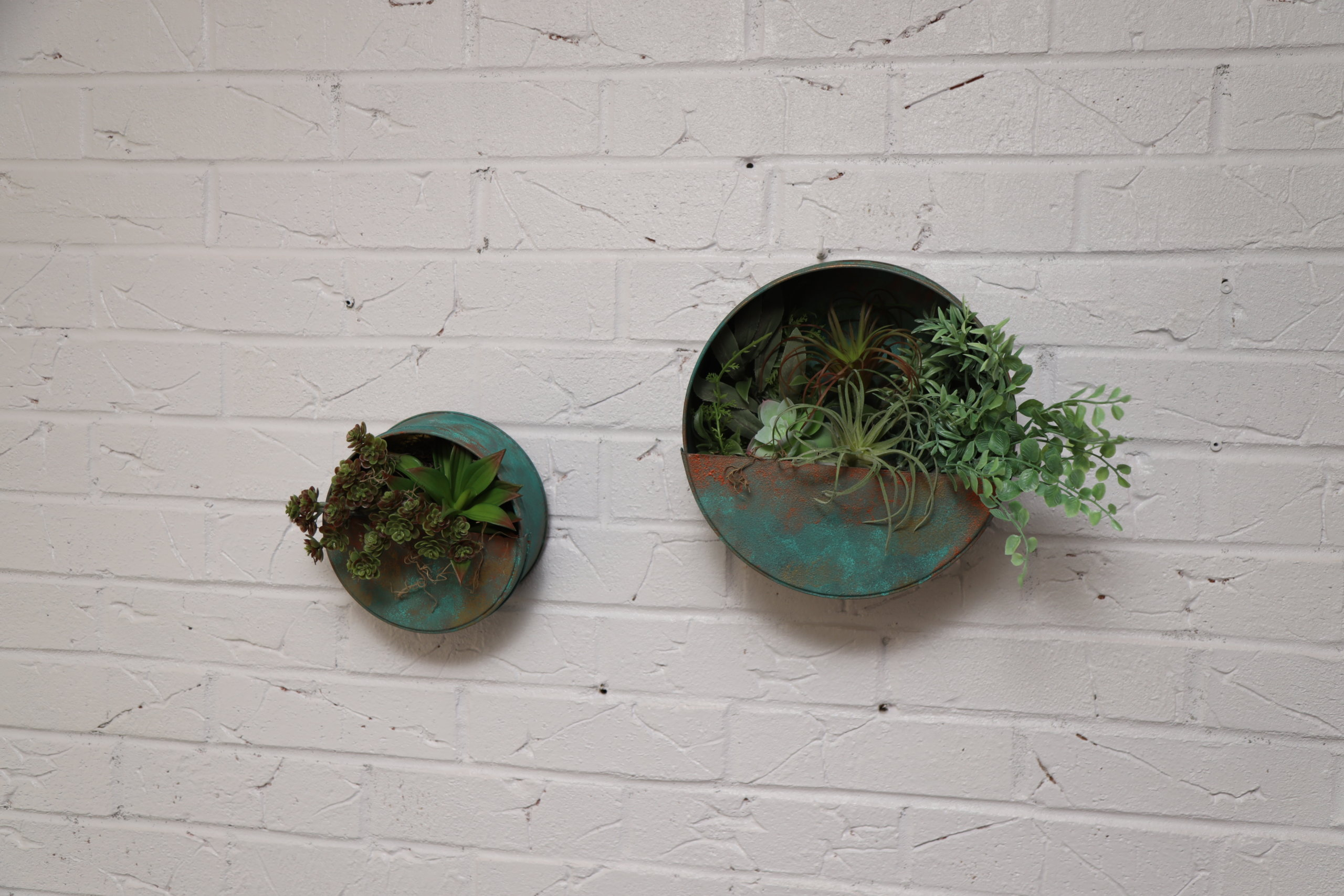 finished patina planters hanging on wall