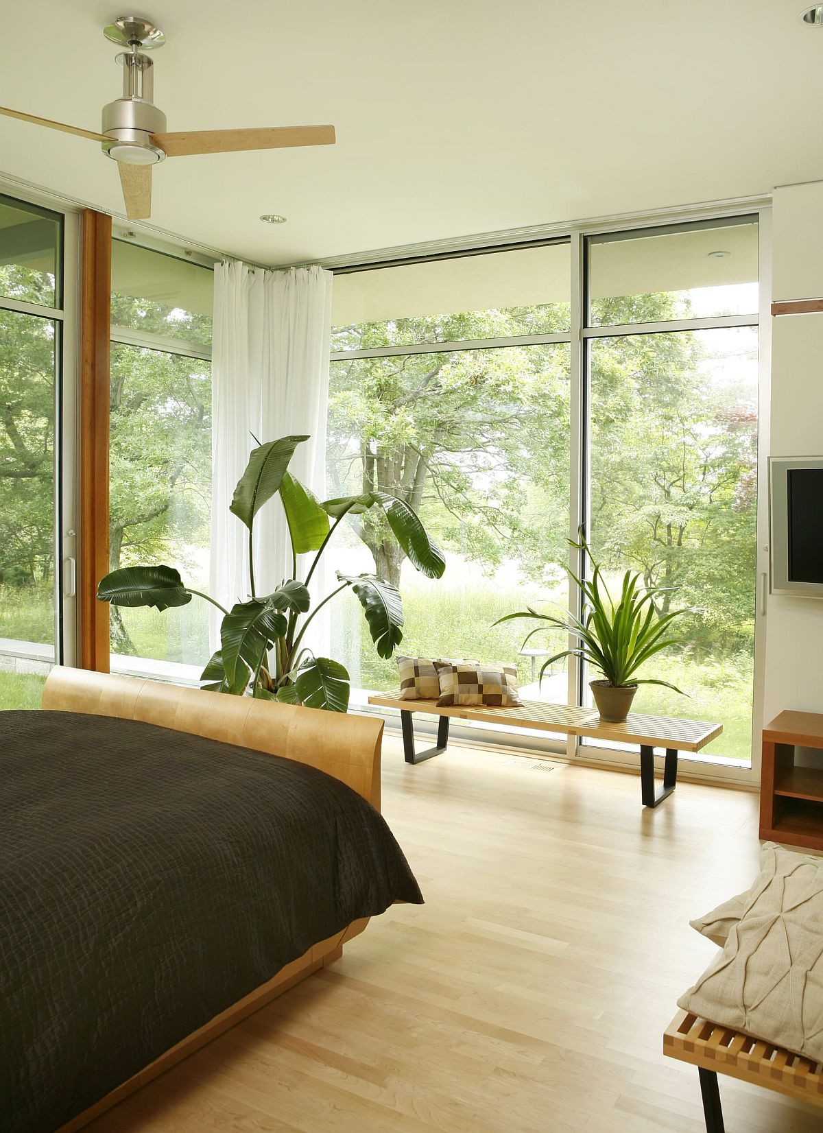 Allow the world outside to bring color into the bedroom along with freshness