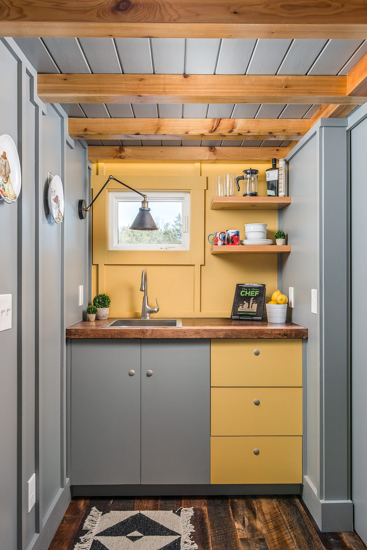 Awesome tiny home kitchen in gray and light yellow