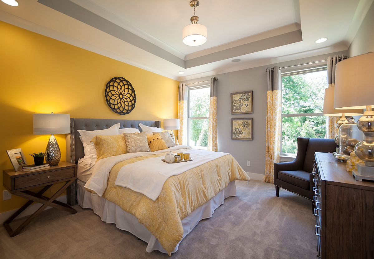 Balanced use of yellow and gray in the spacious modern bedroom