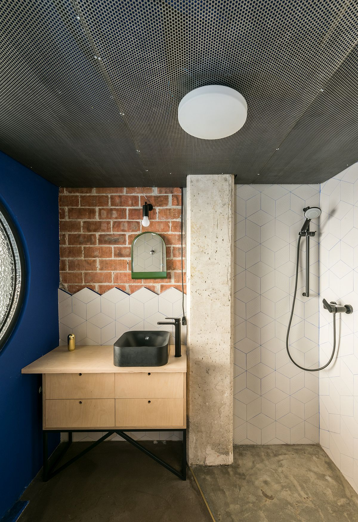 Beautiful modern industrial bathroom with plenty of pattern and textural contrast