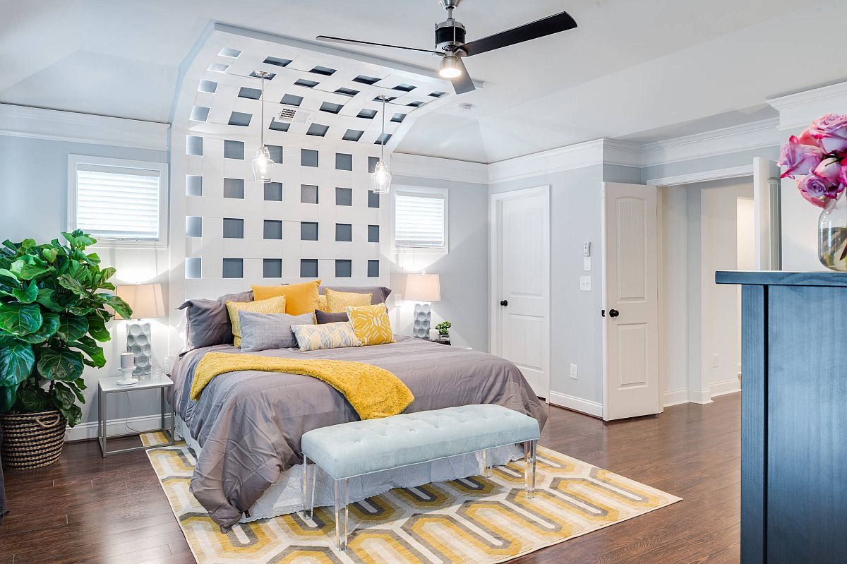 Bedding is used to add yellow and gray to the modern neutral bedroom along with the smart rug