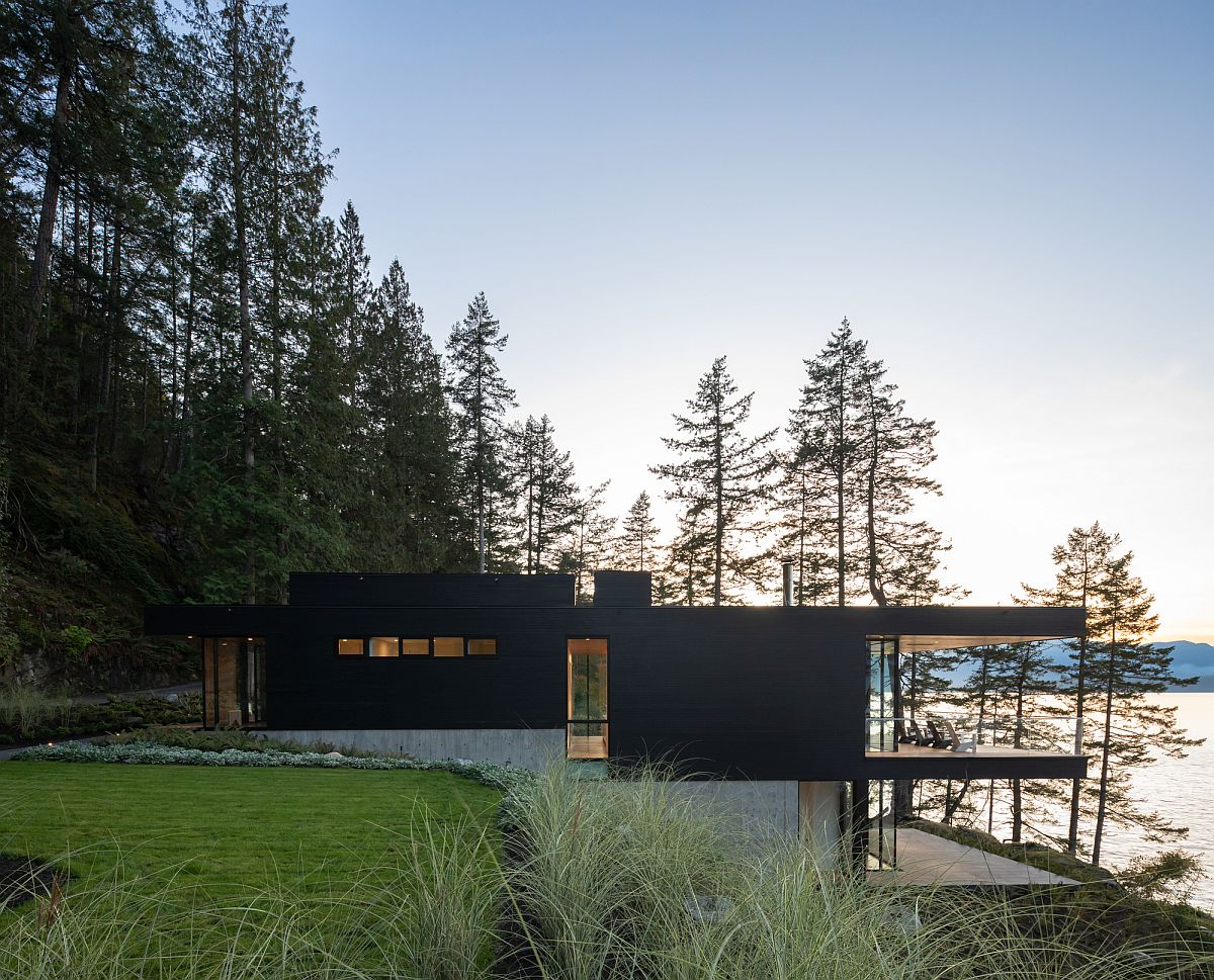 Black stained cedar allows the lovely retreat to blend into the forest-scape after sunset with ease