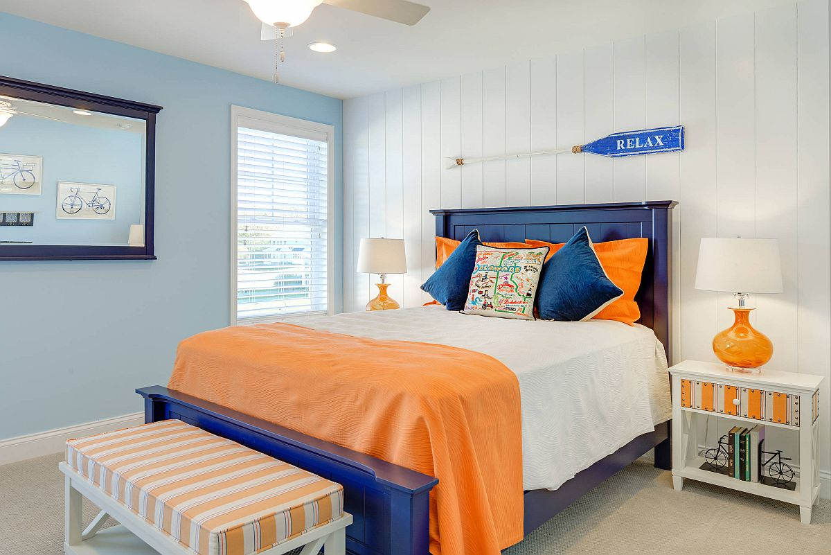 Blue and orange accents added to the neutral bedroom to usher in nautical style