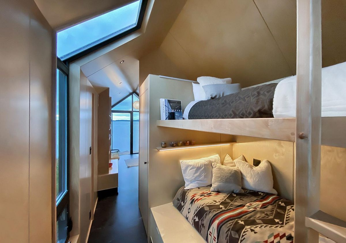 Bunk beds inside the cabin with queen bed for two and a single bed above