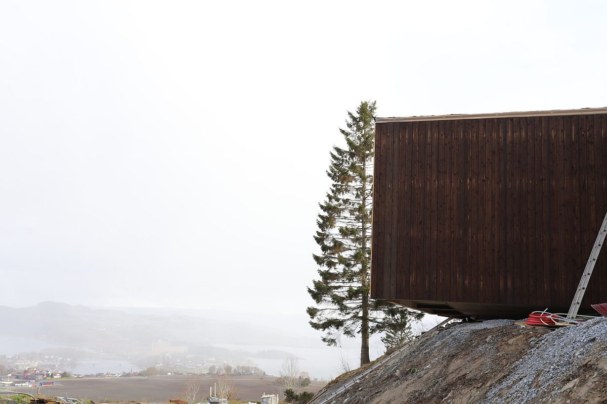 Cabin-style wooden units have been anchored to the ground even as the overlook distant landscape