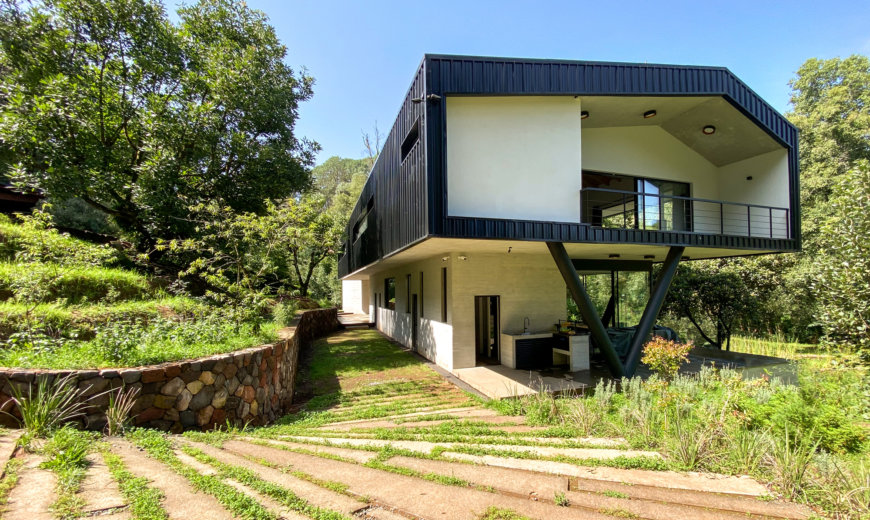 Eco-Friendly Ocoxal House: Modern Forest House Powered by Clean Energy