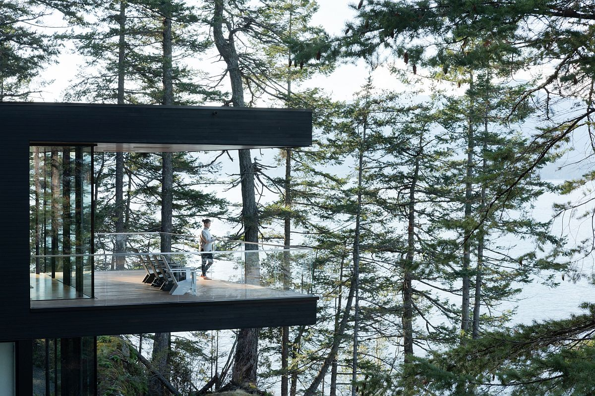 Cantilevered upper level of the house and deck take you above the forest canopy and provide captivating views