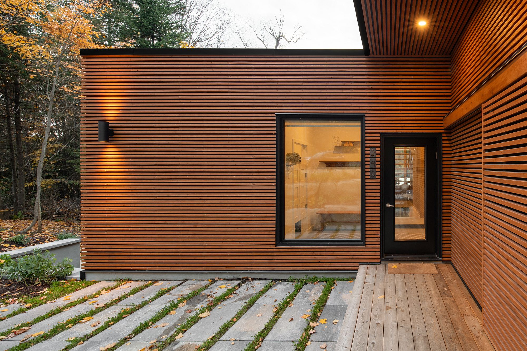 Charming exterior of the home with natural-looking finish combined with dark trims