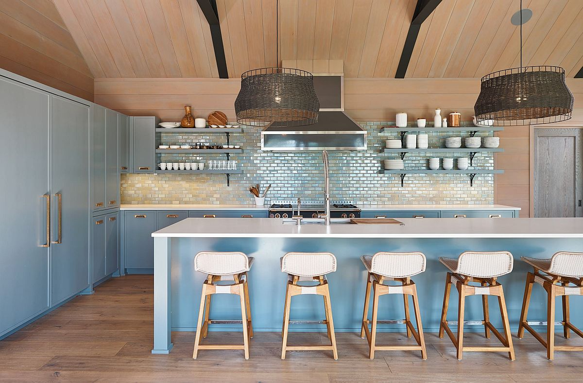 Classy and sparkling tiled backsplash for the kitchen in blue with modern rustic style