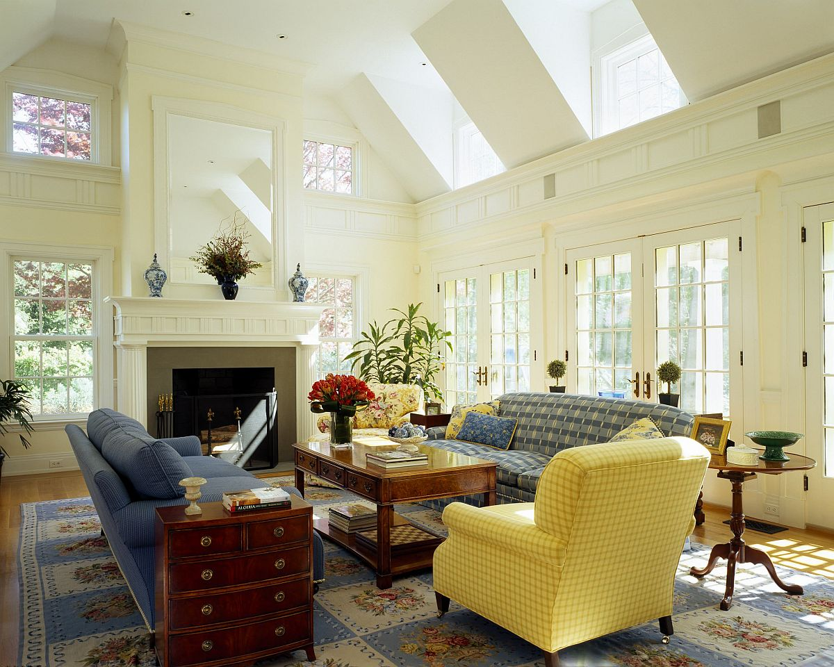 Clerestory windows and large windows bring ample natural light to this living room