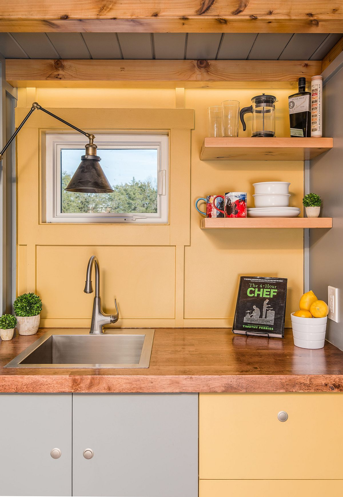Closer look at the ultra-tiny kitchen in yellow and gray