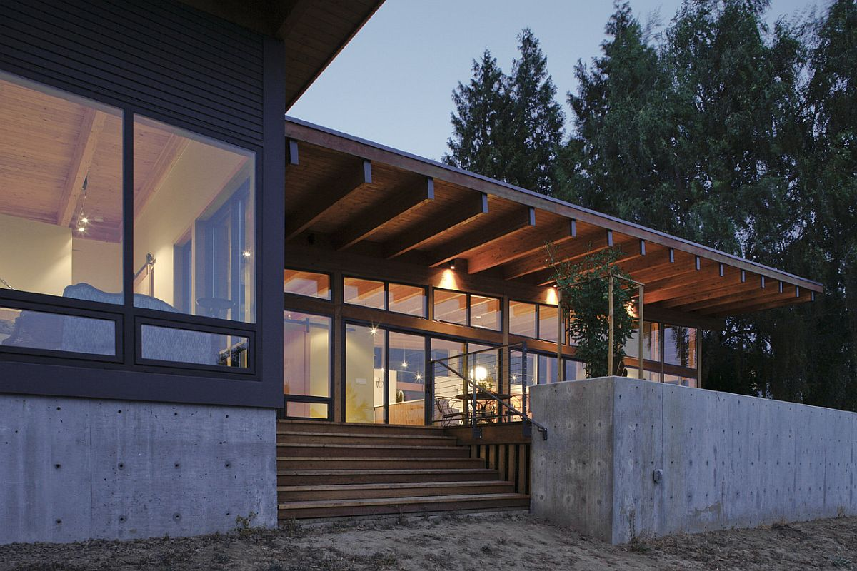 Concrete base of the budget home in Vancouver with wood and glass walls