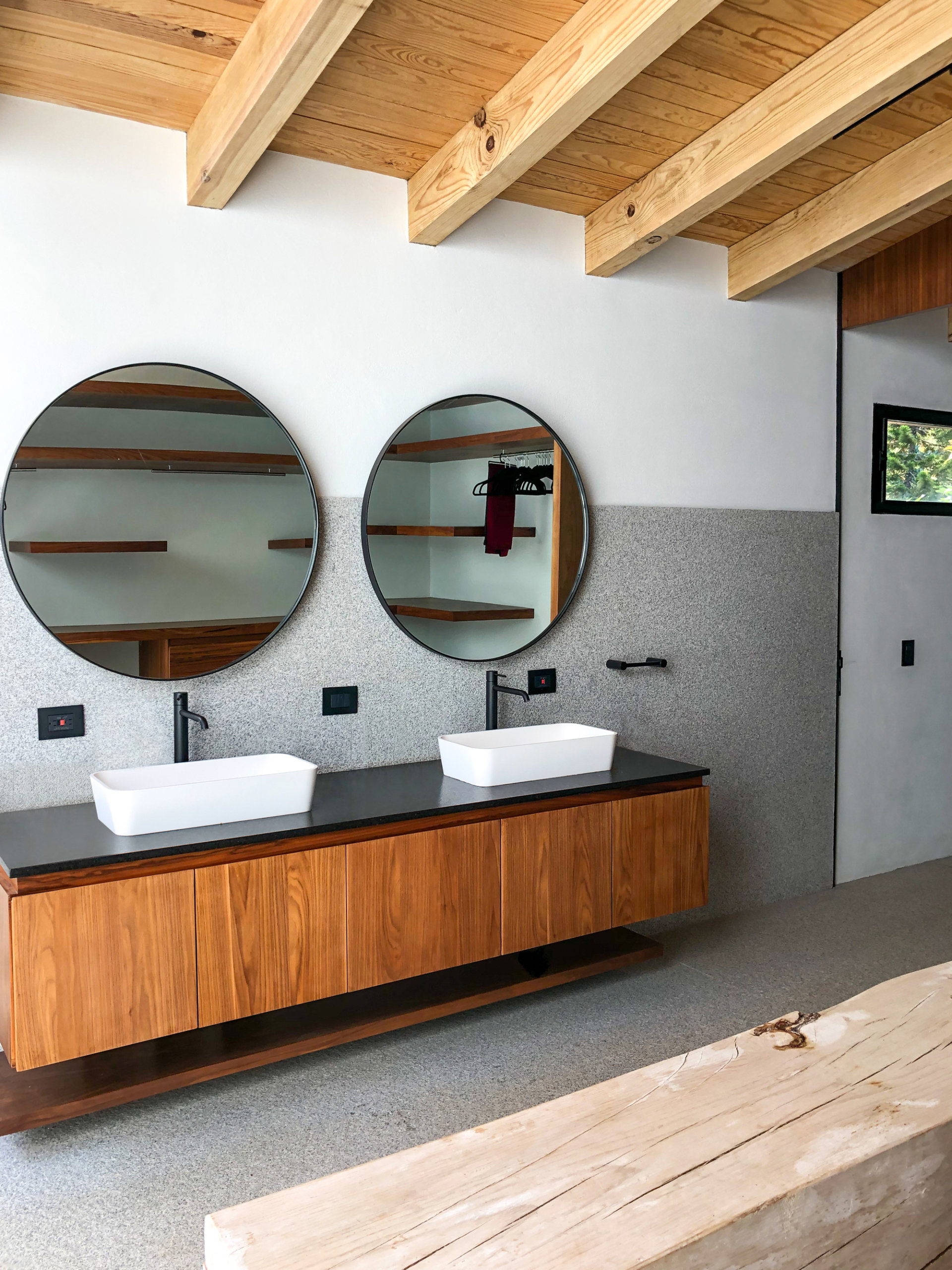 Contemporary bathroom of Eco-friendly Mexican Home with woden ceiling beams and concrete floor