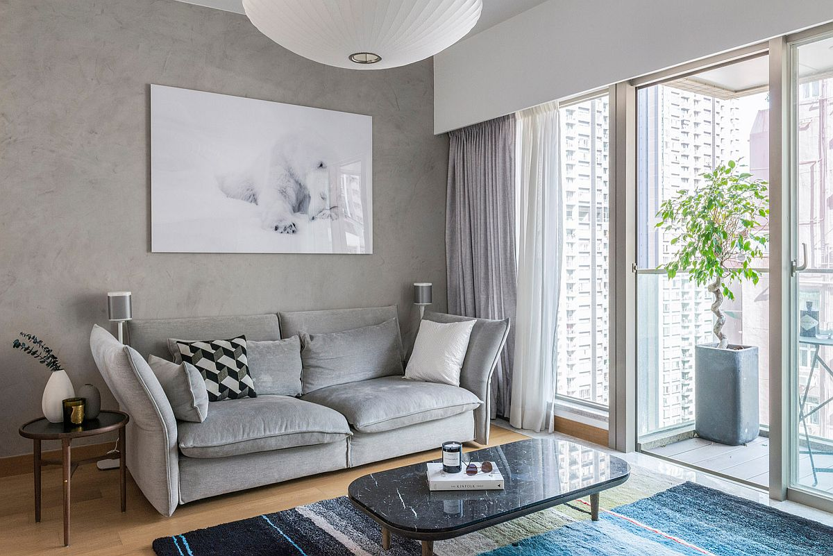 Contemporary living room of apartment in Hong kong with gray accents and a lovely accent wall