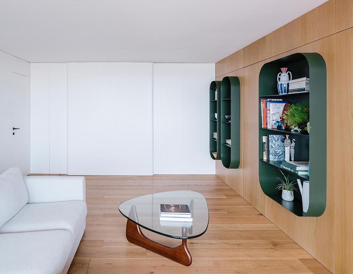 Cozy wooden walls accentuate the appeal of the metallic green shelves