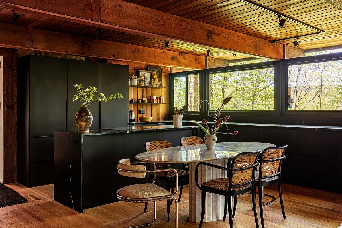 Dark and dashing finishes make the biggest impact in this space-savvy rustic kitchen