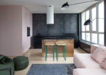 Dark-kitchen-in-backdrop-with-custom-brass-island-and-colorful-bar-stools-64269-217x155