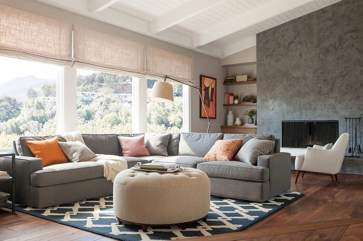 Dark pattern of the rug makes a big impact in this modern neutral living room
