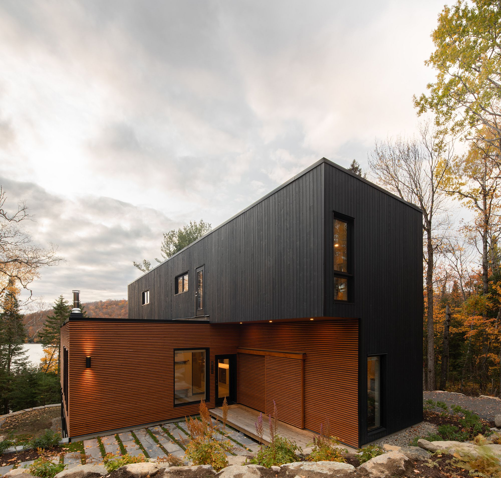 Dark upper level of the home stands in contrast to the natural lower level exterior finish